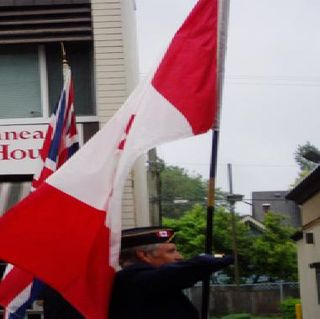 Can flag in parade